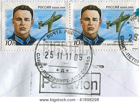 RUSSIA - CIRCA 2009: Postage stamps printed in Russia dedicated to Grigory Bakhchivanji (1909-1943), Hero of the Soviet Union, pilot and captain, circa 2009.