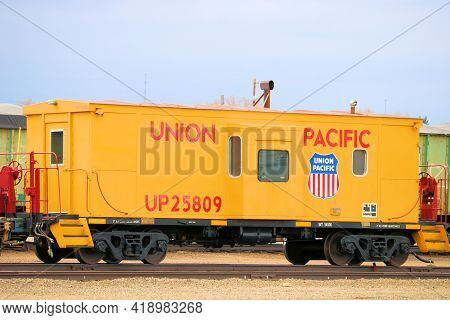 April 26, 2021 In Cheyenne, Wy:  Vintage Railroad Caboose Taken At The Union Pacific Railroad Yard T
