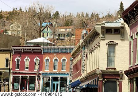 April 25, 2021 In Central City, Co:  Vintage Buildings At The Downtown District With Homes On A Hill
