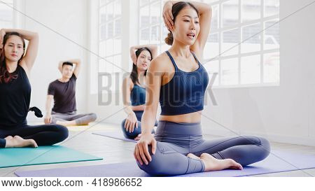 Young Asian Sporty Attractive People Practicing Yoga Lesson With Instructor. Asia Group Of Women Exe
