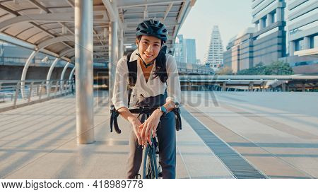 Asian Businesswoman Go To Work At Office Stand And Smiling Wear Backpack Look At Camera With Bicycle