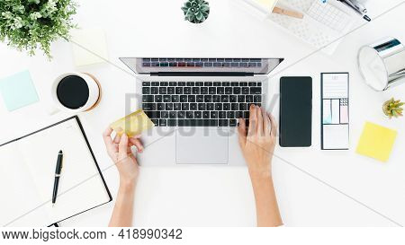 Top View Of Freelance Asia Lady Casual Using Laptop Online Shopping With Credit Card On Table In Liv