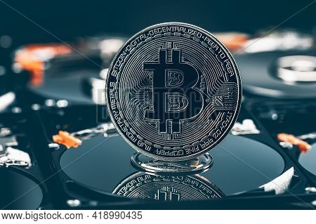 Bitcoin On The Background Of Hard Drives, The Concept Of Mining Cryptocurrencies Using Hard And Ssd