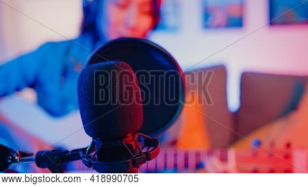 Happy Asia Girl Blogger Play Guitar And Use Microphone Sing Song Record Music Sound Mixer On Laptop