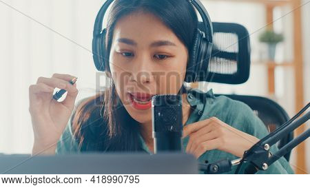 Happy Asia Girl Record A Podcast On Her Laptop Computer With Headphones And Microphone Talk With Aud