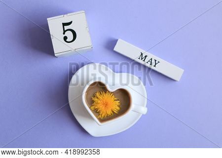 Calendar For May 5: A Cube With The Number 5, The Name Of The Month Of May In English, A Cup Of Coff