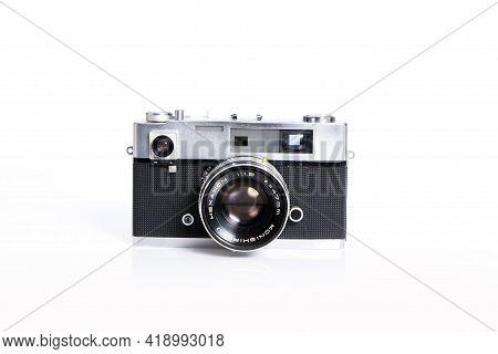 Old Vintage Rangefinder Camera On White Background.