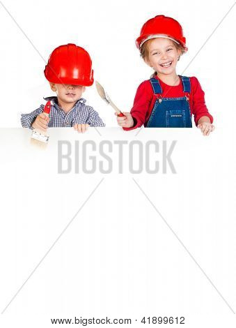 Pretty little girl and boy in halmet with white banner