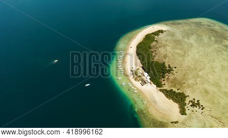 Tropical Island And Sandy Beach With Tourists Surrounded By Coral Reef And Blue Sea In Honda Bay, Ae