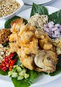 Thai healthy food Deep fried fish with Herb salad and peanut sweet sauce. poster