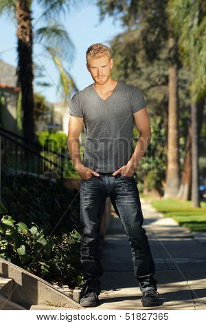 Young good looking casual guy outdoors