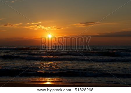 Beautiful sunset above the sea, multicolored sunset, dramatic background, Sunset on the Beach with beautiful colorful dramatic sky and sun reflection in sunset, Baltic sea. Dramatic sunset.Saturate. poster