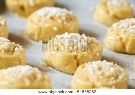 Raw sweet buns on baking sheet