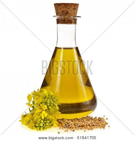 oil glass jar and mustard seeds with flower isolated on white background