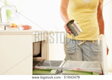 Close Up Of Woman Recycling Kitchen Waste In Bin