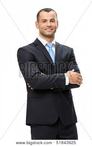 Half-length portrait of business man with hands crossed, isolated on white background. Concept of leadership and success