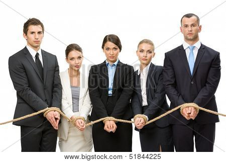 Hands of group of business people are tied with rope, isolated on white. Concept of routine work and slavery