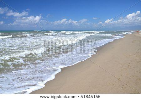 Restless sea on sandy beach Marina di Vecchiano nearby Pisa, Tuscany in Italy