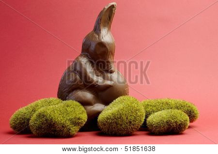 Australian Alternative To The Easter Bunny Rabbit, A Chocolate Bilby Holding An Egg On Green Moss Ro