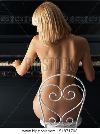 Nude Blond Girl Playing On Piano
