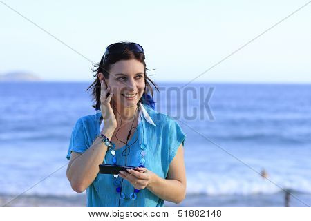 woman talking on phone on the beach, according to the headset poster