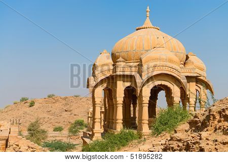 Chhatris on ruins of the royal cenotaphs of ancient Maharajas rulers in Bada Bagh also called Barabagh (literally Big Garden) Jaisalmer India poster