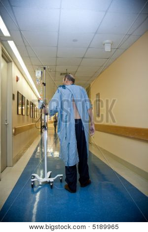 Patient Wlaking Down The Hospital Corridor