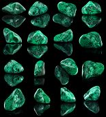 Collection set of malachite mineral stone close up  with reflection on black surface background poster