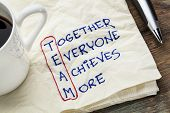 TEAM acronym (together everyone achieves more), teamwork motivation concept - a napkin doodle poster