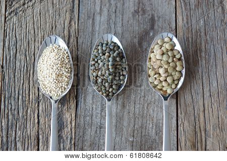 Three Spoons Holding Healthy Seed Like Grains