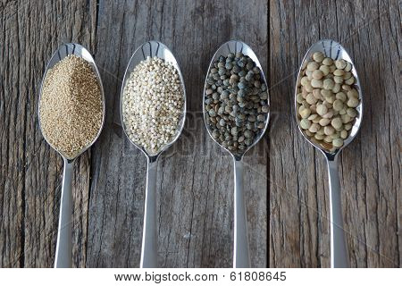 Four Spoons Holding Healthy Seed Like Grains