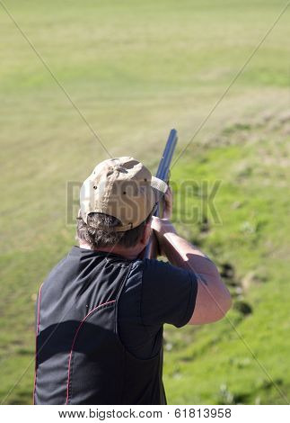 Clay Shooter Firing The Gun