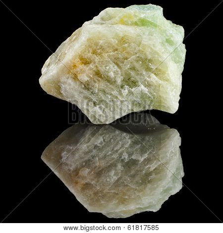 rough Aquamarine  natural crystals   with reflection on black surface background