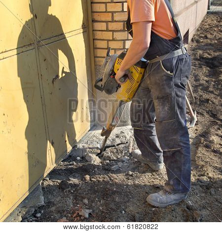 Construction Site, Worker And Jackhammer Tool