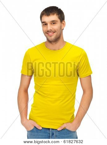 clothing design and hapy people concept - handsome man in blank yellow shirt