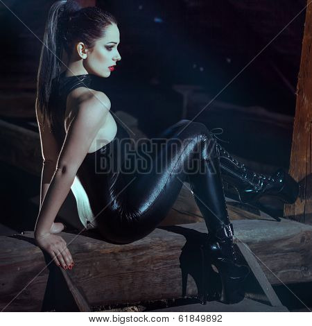 Sexy Woman Sit On Timber At Night