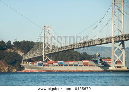 Cargo Ship Under San Francisco Bay Bridge
