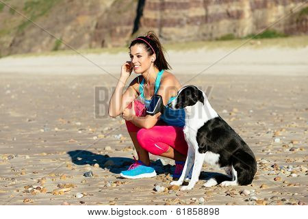Fitness Woman And Dog On Beach
