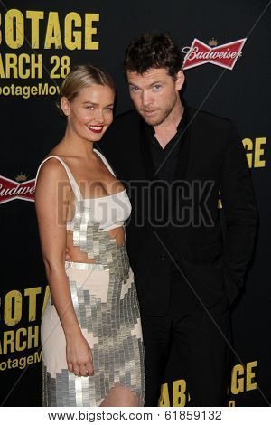 LOS ANGELES - MAR 19:  Lara Bingle, Sam Worthington at the PaleyFEST 2014 Sleepy Hollow at Regal 14 Theaters on March 19, 2014 in Los Angeles, CA