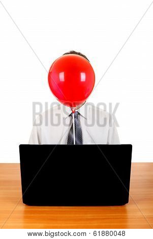 Person With Balloon Behind Laptop