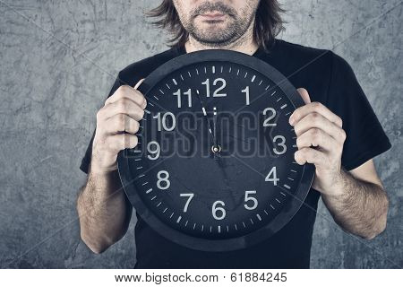 Man Holding Big Black Clock
