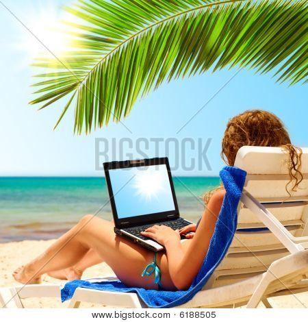 Laptop On Beach Sun