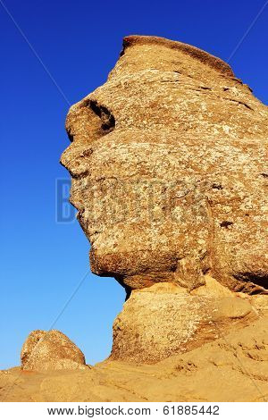 View of Sfinx, a natural mountain formation in the form of a human face meditating in Busteni, Romania
