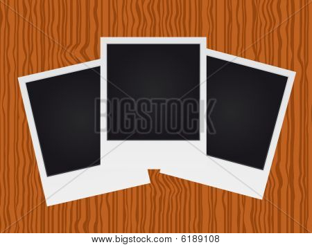 Set of blank photos on wood texture