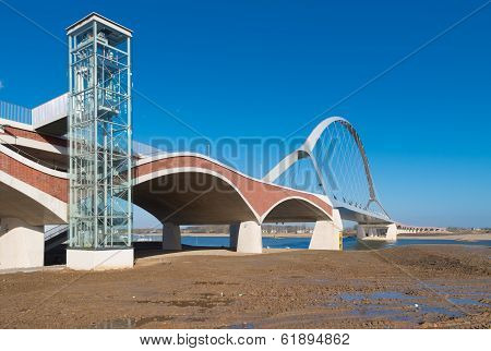 newly build arch bridge in Nijmegen Netherlands. It connects the city with the newer residential areas on the north side of the Waal river poster