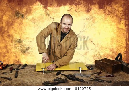 fine portrait of craftsman at work and grunge background poster