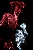 Mystic Smoke shows colored smoke with black background. poster