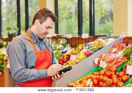 Store manager in supermarket using a mobile data registration terminal