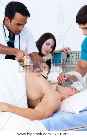 A Diverse Medical Team Resuscitating A Patient