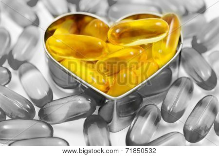 Fish Oil Pills On Heart Shape Box Isolated Split Tone Version